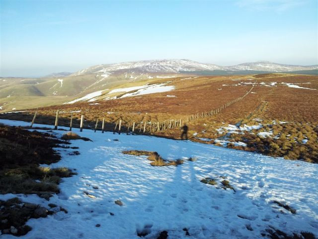 Heading up to Windy Gyle, looking back down the Border Fence to the lumpy Cheviot
