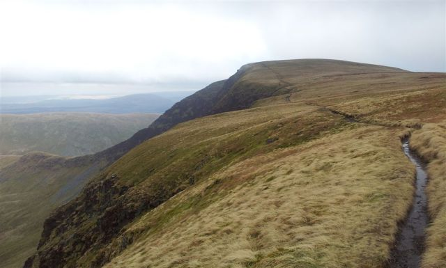 Walking up to Bannerdale Crags ahead, clear but for how long