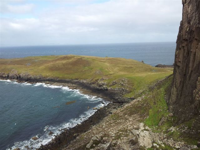The path cuts across & under the basalt cliffs