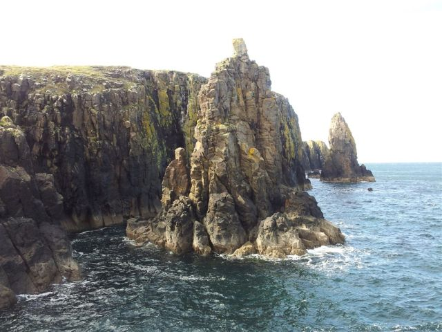 Taking a food stop. Sea stacks with old ropes at the top, not for me!