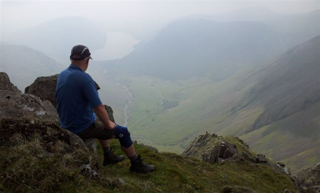 A man alone with his knee supports remembering early hillwalking days in Wasdale