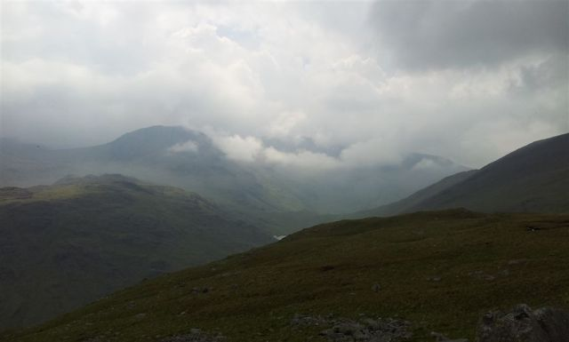 Moody shot of Great End & the Scafells with glimpse of Styhead Tarn in middle