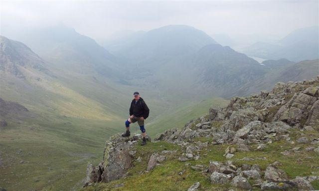A man & his knee supports on Green Gable, Ennerdale & Buttermere behind