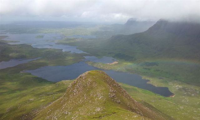 Heading up Cul Beag with mighty fine views north over Assynt, (spot the rainbow)