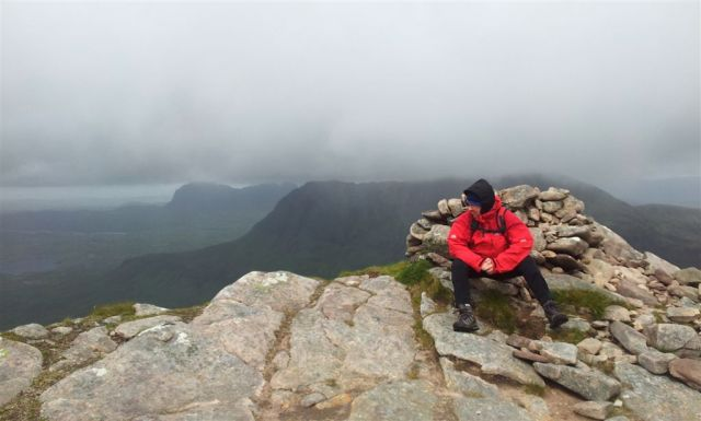On the summit of Cul Beag, trying to look relaxed in storm force winds