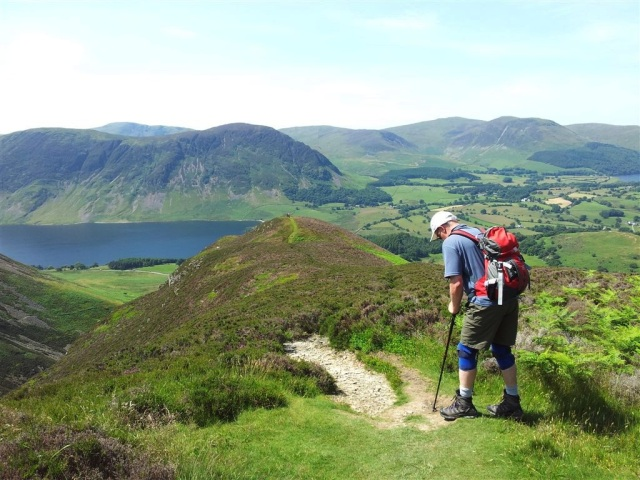 A man with highly honed mountain fitness and Crummock Water & Mellbreak