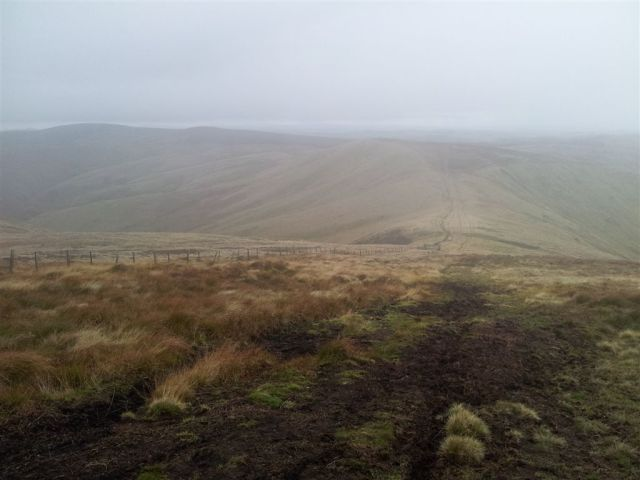 Leaving the cloud from Windy Gyle heading west