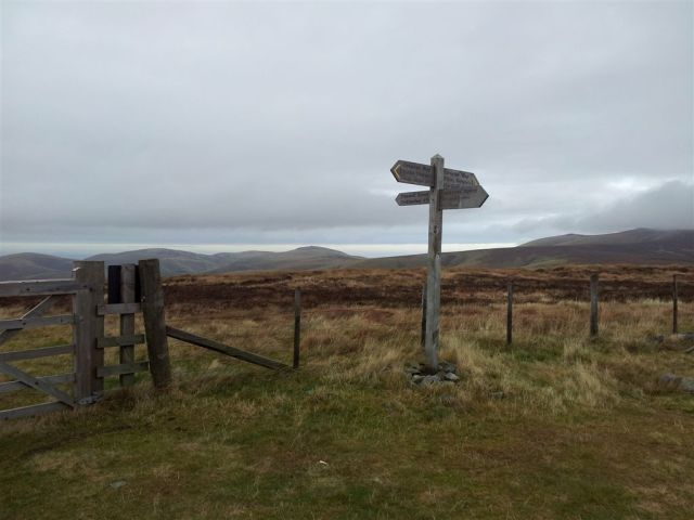 The Border Fence & sudden views over The Schill & cloudy Cheviot shoulder