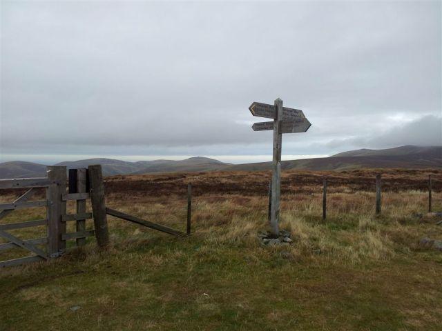 The Border Fence & sudden views over The Schill & cloudy Cheviot shoulder