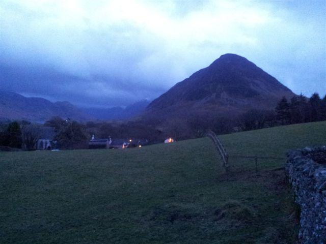 Peaceful Melbreak with the lights of the Kirkstile Inn