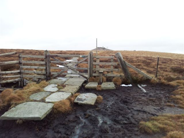 The muddy stile leads to Windy Gyle summit